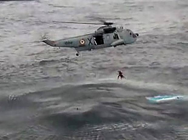 A Navy helicopter rescues fishermen in the wake of cyclone Ockhi, in Lakshadweep on Saturday. (Photo: PTI/TV Grab)