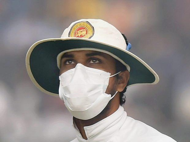 Sri Lankan captain Dinesh Chandimal wears anti-pollution mask on the field, as the air quality deteriorates during the second day of their third test cricket match against India in New Delhi File Photo PTI