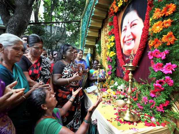 AIADMK woman members paying tribute to former chief minister J Jayalalithaa on her first death anniversary in Coimbatore. Photo: PTI