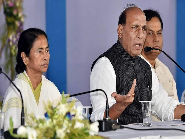 Union Home Minister Rajnath Singh, West Bengal Chief Minister Mamata Banerjee and Assam Chief Minister Sarbananda Sonowal