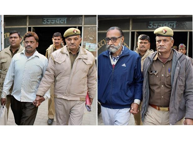 Noida businessman Moninder Singh Pandher and his domestic help Surendra Koli being taken to jail after a special CBI court in Ghaziabad sentenced them to death on Friday in connection with one of the 16 murder cases infamous as the Nithari killings.