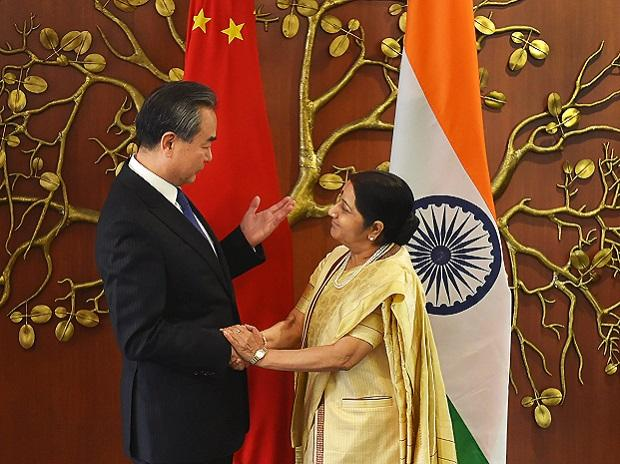 Delhi: Minister for External Affairs Sushma Swaraj and her Chinese counterpart  Wang Yi, exchange greetings before a meeting in New Delhi on Monday. Photo: PTI