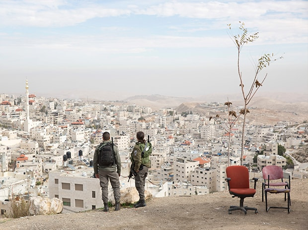 Israeli border police officers overlooking the Arab neighborhood of Issawiyah in Jerusalem