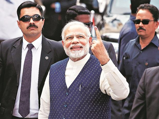 PM Modi flashes victory sign as BJP takes lead in Gujarat, Himachal