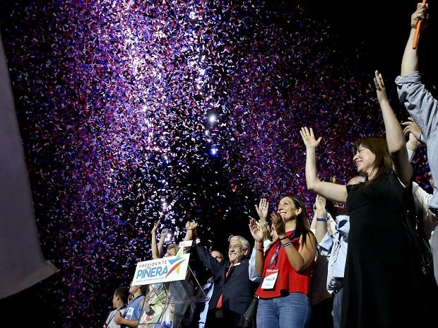 Former President Sebastian Pinera waves to supporters under a shower of confetti as he celebrates winning the presidential election runoff in Santiago. Photo: AP/PTI Photo