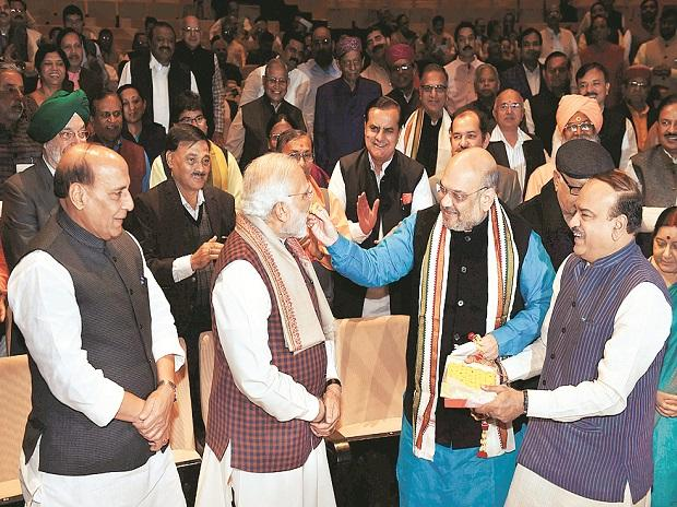 Prime Minister Narendra Modi and BJP President Amit Shah celebrate the party's success in Gujarat and Himachal Pradesh Assembly elections, during the Parliamentary board meeting in New Delhi on Wednesday. Photo: pti