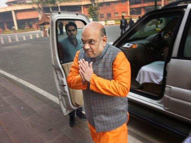 BJP leader Amit Shah arrives at the Parliament House in New Delhi