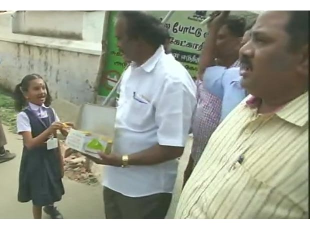 DMK supporters distribute sweets in celebration in Coimbatore after the acquittal of all the accused in #2GScamVerdict by Delhi's Patiala House Court. (Photo: ANI)