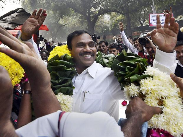 Former Telecom minister A Raja waves at his supporters after he was acquitted by a special court in the 2G scam case, in New Delhi