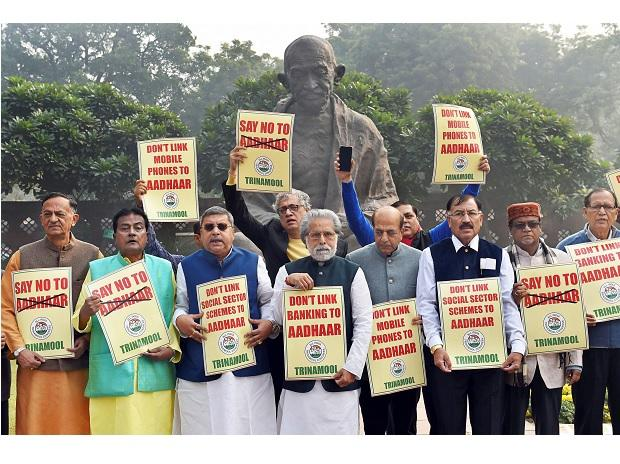 TMC members protesting  against NDA government over proposal to make Aadhaar linkage mandatory outside the Parliament House in New Delhi on Thursday. (Photo: PTI)