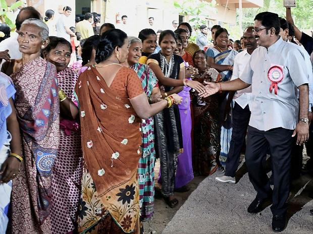 Sidelined AIADMK leader TTV Dhinakaran who is contesting as an independent candidate greeting voters at a polling booth during voting for the Dr Radhakrishnan Nagar Assembly constituency bypoll in Chennai. (Photo: PTI)