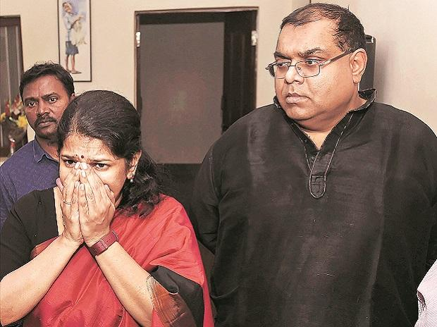 DMK MP Kanimozhi reacts while talking to the media at her residence after she was acquitted by a special court in the 2G scam case, in New Delhi on Thursday. Husband G Aravindan looks on. Photo: PTI