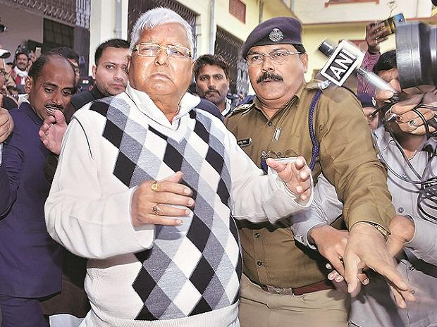 RJD chief Lalu Prasad after being convicted in fodder scam case, in Ranchi on Saturday. Photo: PTI