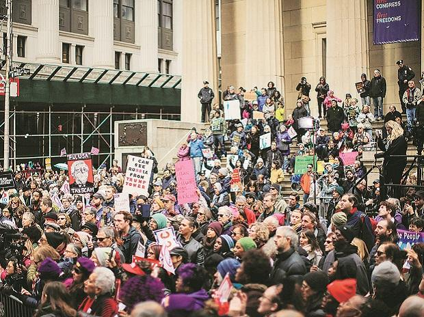 Demonstrators protest against tax reforms near the New York Stock Exchange on 2 December, 2017. Photo: Reuters