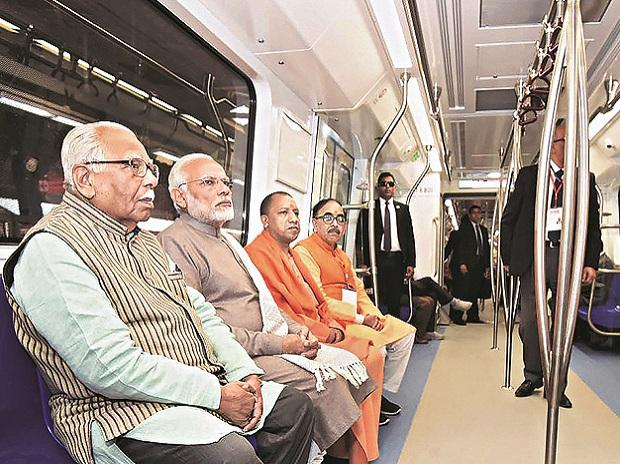 Prime Minister Narendra Modi rides a metro on the Magenta Line with (from left) UP Governor Ram Naik and Chief Minister Yogi Adityanath after its inauguration in Noida on Monday. Photo: PTI