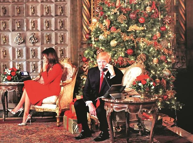 President Donald Trump and First Lady Melania Trump participate in NORAD Santa Tracker phone calls with children at Mar-a-Lago estate in Palm Beach on December 24. Photo: Reuters