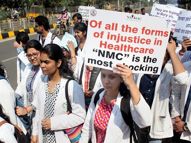 Medical students observe black day during a protest rally against NMC (National Medical Commission) in Bhubaneswar on Tuesday. Photo: PTI