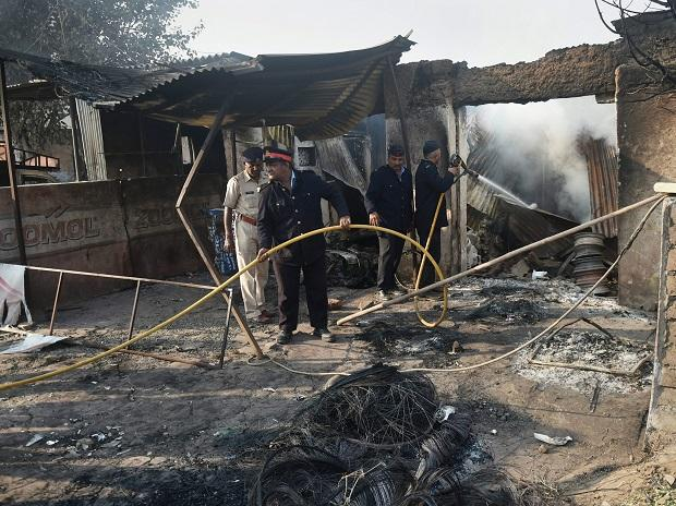 Police and fire men at a charred shop following the violence during celebrations of 200th anniversary of the Battle of Bhima Koregaon, near Pune. Photo: PTI