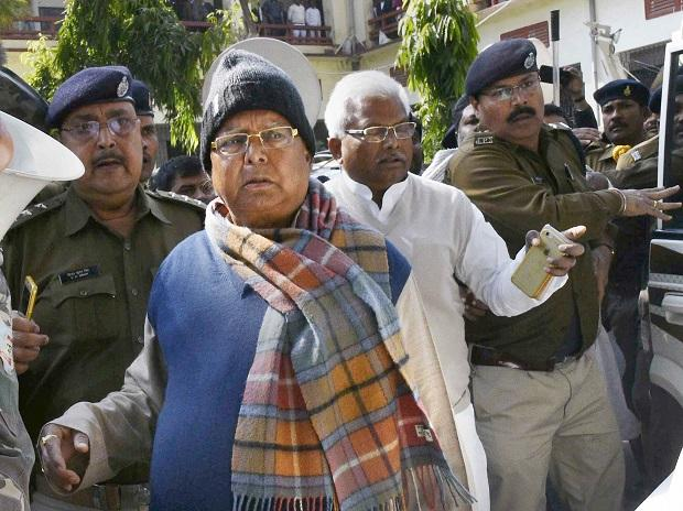 Bihar's former chief minister Lalu Yadav escorted by police officials after appearing at the special CBI court, in Ranchi. Photo: PTI