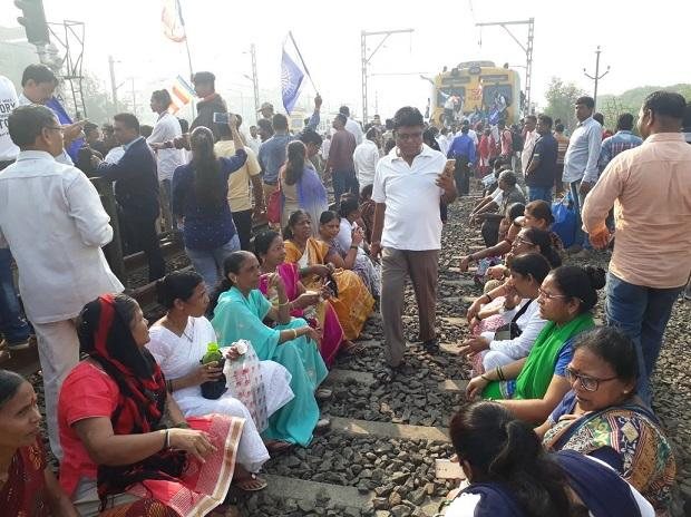 Large number of protesters have occupied the railway tracks at Nallasopara Station, disrupting rail traffic. Photo: ANI