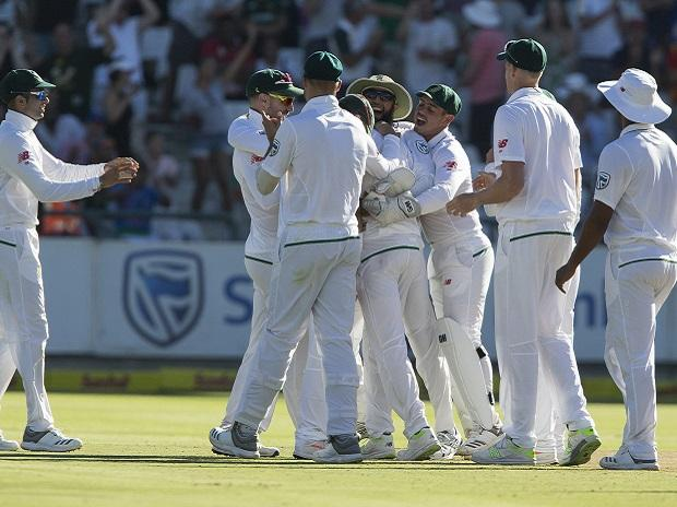 South Africa players celebrate the wicket of Shikhar Dhawan on the first day of the first test between South Africa and India at Newlands Stadium, in Cape Town. Photo: PTI
