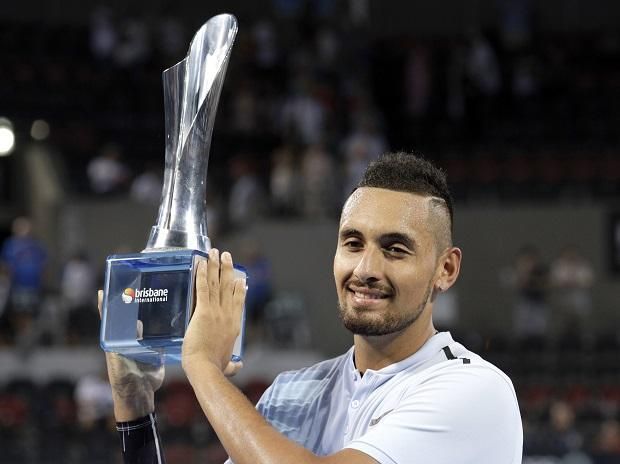 Nick Kyrgios of Australia holds the trophy after winning his final match against Ryan Harrison of the U.S. 6-4, 6-2, during the Brisbane International tennis tournament in Brisbane, Australia: Photo: AP | PTI