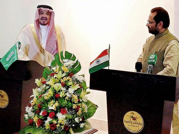 Saudi Arabia's Haj and Umrah minister Dr Mohammad Saleh bin Taher Benten speaks while India's Minister of Minority Affairs Mukhtar Abbas Naqvi looks on during the signing of the bilateral Haj Agreement signing between India and Saudi Arabia, in Makka