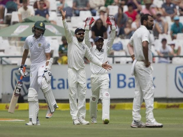 Indian captain Virat Kohli, second left, and Wriddhiman Saha, second right, appeal a wicket on the fourth day of the first test between South Africa and India at Newlands Stadium, in Cape Town, South Africa. Photo: AP/PTI
