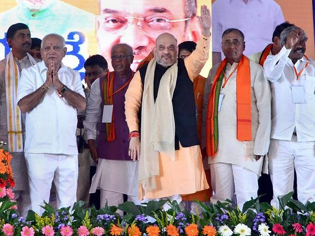 BJP President Amit Shah, state BJP chief B S Yeddyurappa along other state leaders during Parivartan Yatra, in Chitradurga near Bengaluru. Photo: PTI
