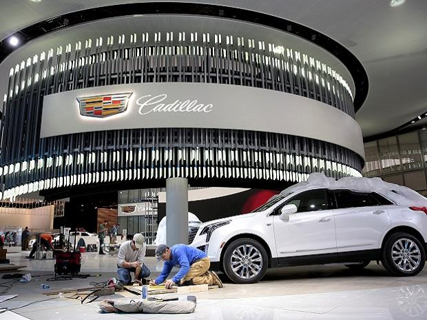 Workers construct the display area for Cadillac before the start of Press Days for the North American International Auto Show at Cobo Center in Detroit. Photo: Reuters