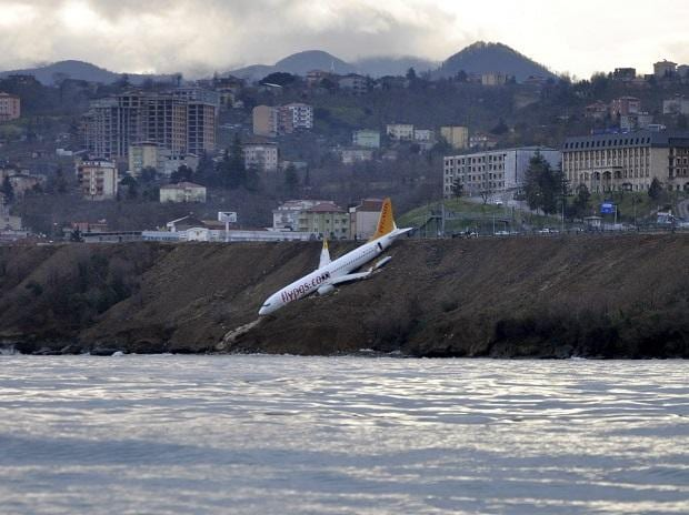 A Boeing 737-800 of Turkey's Pegasus Airlines after skidding off the runway downhill towards the sea at the airport in Trabzon, Turkey. Photo: AP/PTI