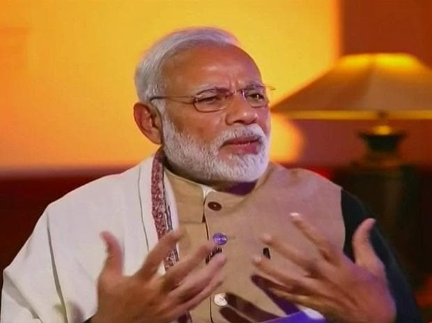 Prime Minister Narendra Modi speaks during an interview with Zee News TV channel telecast on Friday. PTI Photo / Zee News TV Grab
