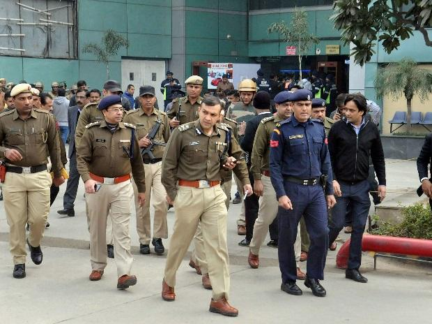 Police personnel outside shopping mall