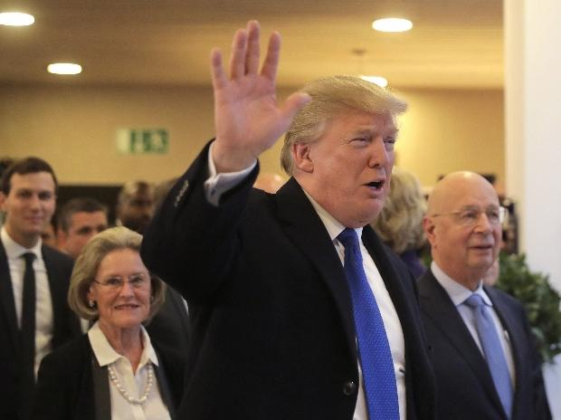 US President Donald Trump waves to journalists as he arrives during the annual meeting of the World Economic Forum in Davos, Switzerland. (Photo: AP/PTI)