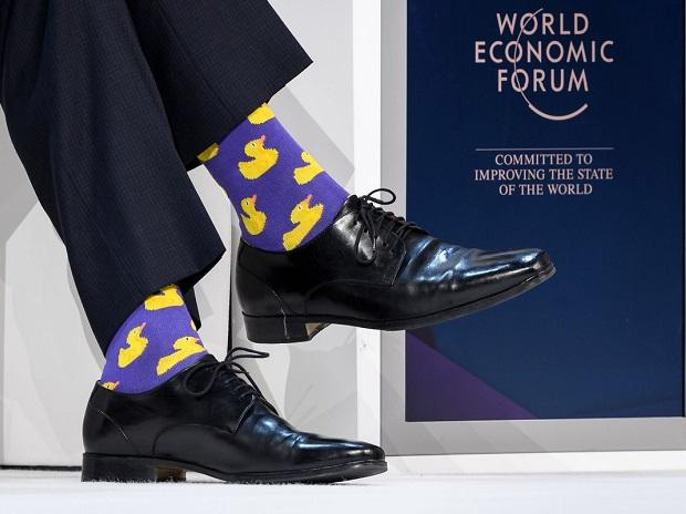 Trudeau's rubber-ducky socks  take fashion diplomacy to new level at Davos