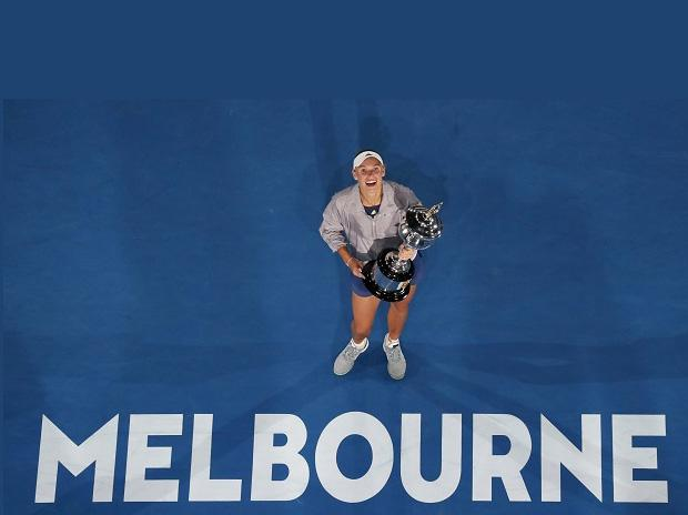 Denmark's Caroline Wozniacki holds her trophy after defeating Romania's Simona Halep during the women's singles final at the Australian Open tennis championships in Melbourne. Photo: AP/PTI