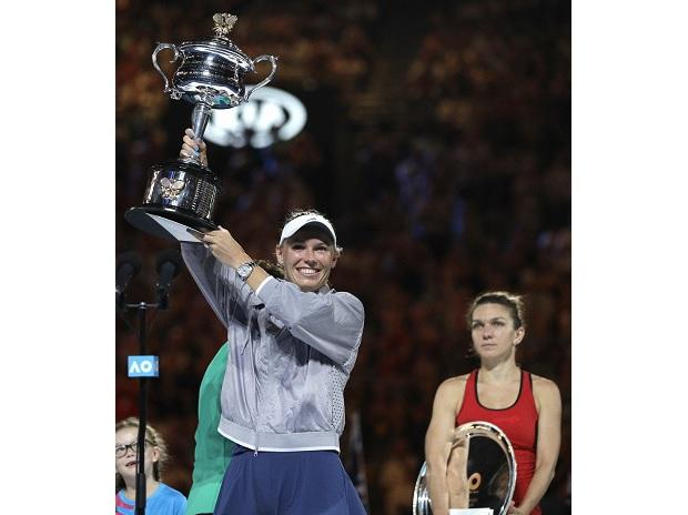 Denmark's Caroline Wozniacki holds her trophy aloft after defeating Romania's Simona Halep during the women's singles final at the Australian Open tennis championships in Melbourne. Photo: AP/PTI