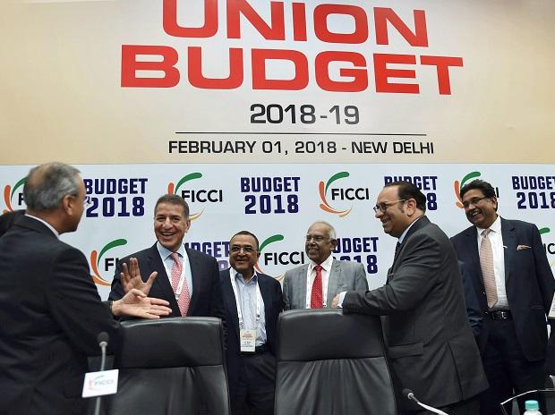 Industrialists Harsh Pati Singhania, KK Modi, Rajan Bharti Mittal and others after watching the live screening of the Union Budget 2018 presentation organized by FICCI in New Delhi on Thursday. PTI Photo