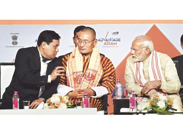 (From left) Assam Chief Minister Sarbananda Sonowal, Bhutanese Prime Minister Dasho Tshering Tobgay and Prime Minister Narendra Modi  at the 'Advantage Assam - Global Investors Summit in Guwahati. Photo: PTI