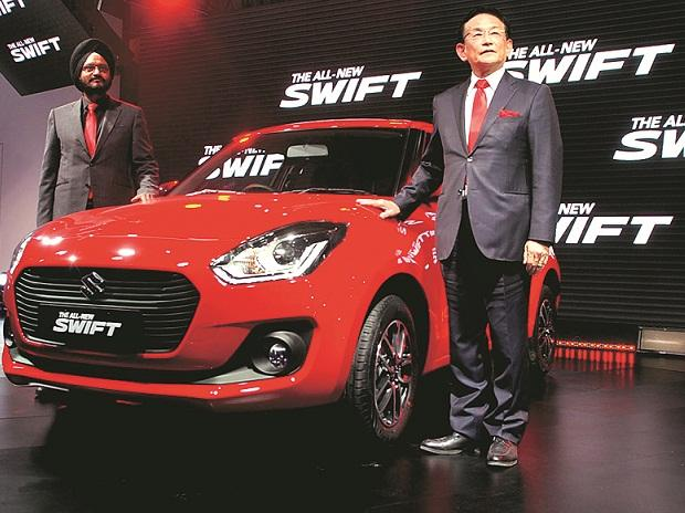 Maruti Suzuki Managing Director and CEO Kenichi Ayukawa (right) and senior executive director RS Kalsi showcase the all-new Swift