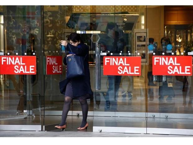 A woman walks out of a shopping mall in Tokyo. (Photo: Reuters)