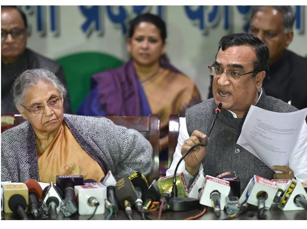 Delhi Congress chief Ajay Maken and former chief minister Sheila Dikshit release a charge sheet against Aam Aadmi Party at a press conference in New Delhi. (PTI Photo)