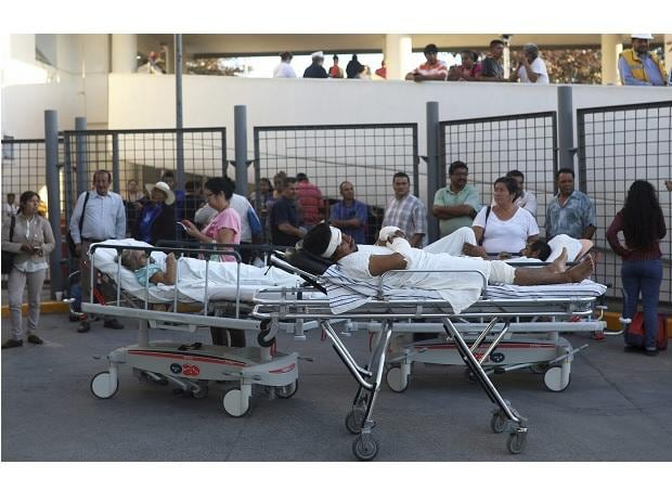 Patients rest in their hospital beds parked outside the General Hospital after they were evacuated, in Veracruz, Mexico. (Photo: AP/PTI)