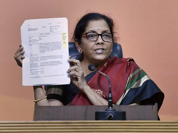 BJP leader and Defence Minister Nirmala Sitharaman shows a document while addressing a press conference on Nirav Modi issue, at BJP headquarters in New Delhi. (Photo: PTI)