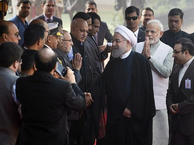 Prime Minister Narendra Modi introduces Indian dignitaries and officials to Iranian President Hassan Rouhani during the latter's ceremonial reception at Rashtrapati Bhavan in New Delhi. (Photo PTI)