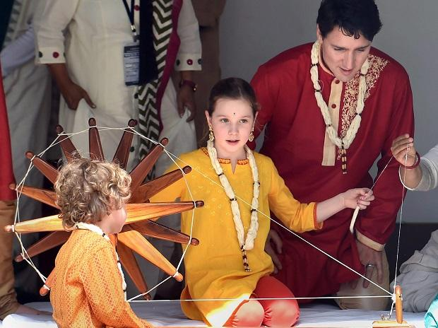 Canadian Prime Minister Justin Trudeau along with his family spins cotton on a traditional 'charkha' in Sabarmati Ashram in Ahmedabad. Photo: PTI