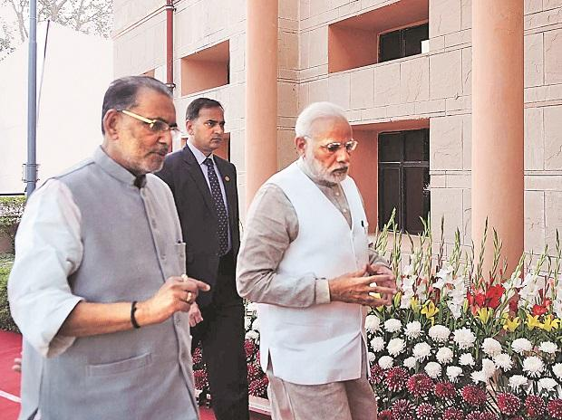 Prime Minister Narendra Modi arrives at a national conference on 'Doubling of Farmers Income by 2022' in New Delhi on Tuesday, accompanied by Union Minister for Agriculture and Farmers Welfare Radha Mohan Singh. Photo: PTI/PIB