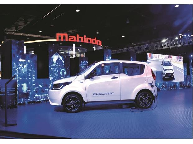 Mahindra & Mahindra E20 electric vehicle at the Auto Expo 2018 held in Noida on February 10. Carmakers need to radically reduce sticker prices for electric vehicles to about $7,000 to entice the average buyer and sell enough cars to have a meaningful