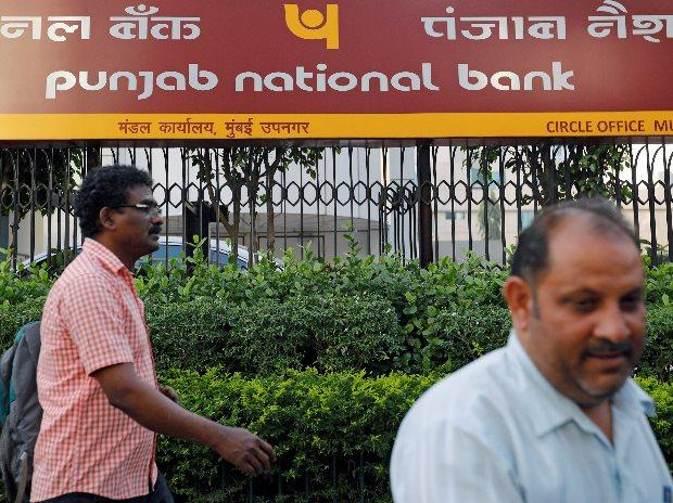 Pedestrians walk past a Punjab National Bank office in Mumbai (Photo: Reuters)