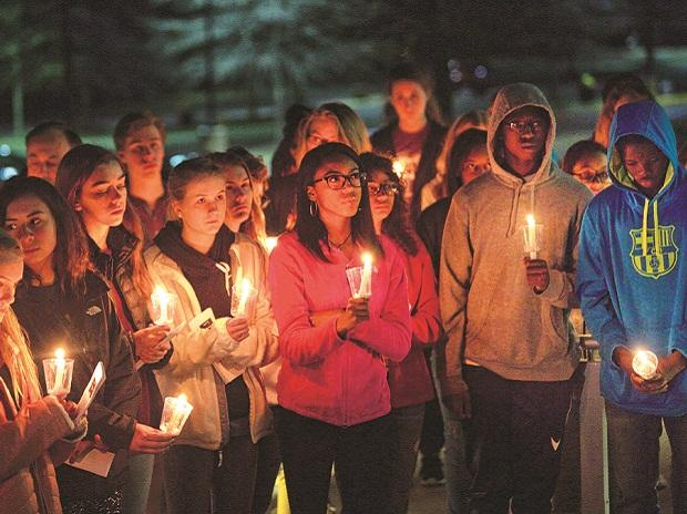 Students hold candlelight vigil after Florida school shooting .